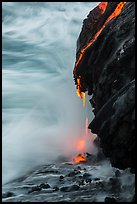 Molten lava drips into the sea. Hawaii Volcanoes National Park, Hawaii, USA. (color)