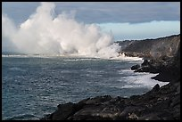 Clouds of smoke and steam produced by lava flowing into ocean. Hawaii Volcanoes National Park, Hawaii, USA. (color)