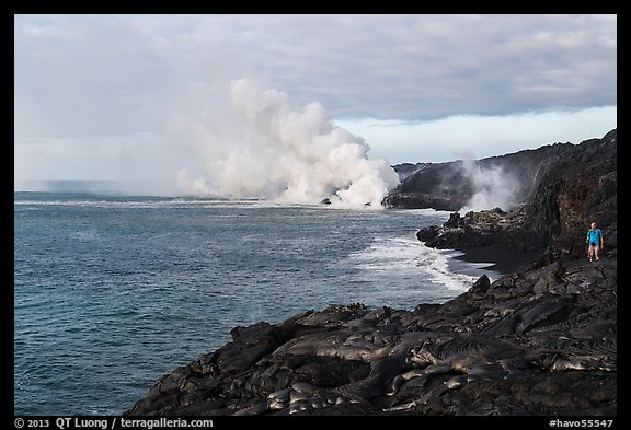 Hiker and volcanic steam cloud on coast. Hawaii Volcanoes National Park (color)