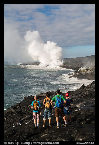 Hikers looking at molten lava and coastal volcanic steam cloud. Hawaii Volcanoes National Park (color)