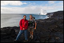 QT Luong and Bryan Lowry at near ocean entry. Hawaii Volcanoes National Park, Hawaii, USA. (color)