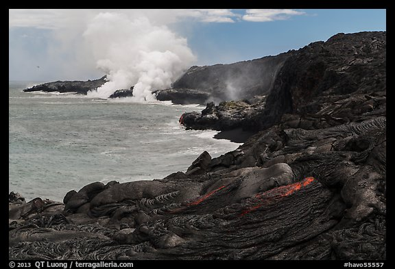 Molten lava flow and ocean plume. Hawaii Volcanoes National Park (color)