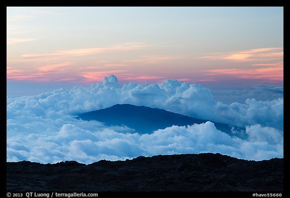 Puu Waawaa summit emerging from sea of clouds at sunset. Hawaii Volcanoes National Park (color)