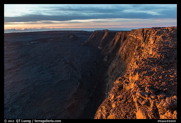 Cliffs bordering Mauna Loa summit caldera from rim at sunrise. Hawaii Volcanoes National Park (color)