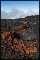 Red and orange lava, rainbow in clouds, Mauna Loa. Hawaii Volcanoes National Park, Hawaii, USA. (color)