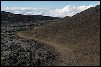 Trail through olivine hill bordering aa lava. Hawaii Volcanoes National Park, Hawaii, USA. (color)