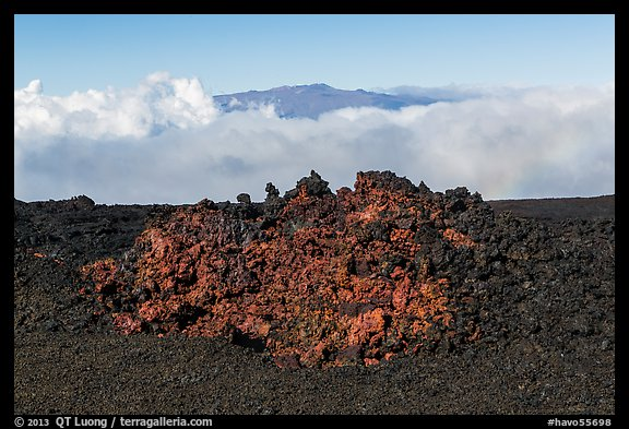 Black of colorful lava on Mauna Loa, Mauna Kea emerging from Saddle clouds. Hawaii Volcanoes National Park (color)