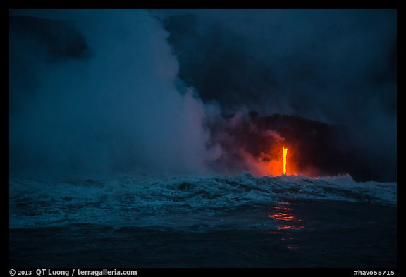 Lava runs down the cliff and goes into the sea at dawn. Hawaii Volcanoes National Park (color)