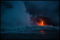 Lava runs down the cliff and goes into the sea at dawn. Hawaii Volcanoes National Park, Hawaii, USA.