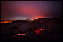Molten lava flow with star trails. Hawaii Volcanoes National Park, Hawaii, USA.