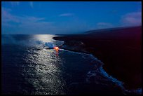 Aerial view of coastline with distant lava ocean entry and moonlight reflections at night. Hawaii Volcanoes National Park ( color)