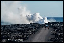 Byciclists and hikers approaching lava ocean entry on emergency road. Hawaii Volcanoes National Park ( color)
