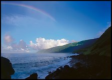 Rainbow and Mataalaosagamai sea cliffs in the distance, Tau Island. National Park of American Samoa