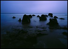 Rocks in water at dusk, Siu Point, Tau Island. National Park of American Samoa ( color)