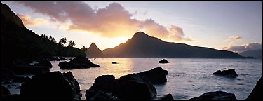 Coastline with boulders at sunrise, Ofu Island. National Park of American Samoa (Panoramic color)