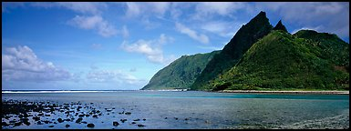 Pointed tropical peaks rising above turquoise waters, Ofu Island. National Park of American Samoa (Panoramic color)