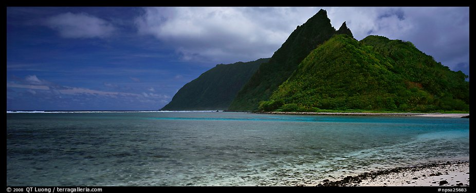 Tropical landscape with blue waters, pointed peaks, and clouds, Ofu Island. National Park of American Samoa (color)