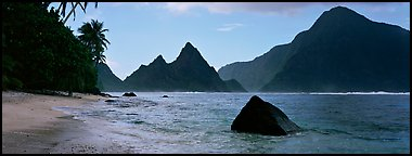 Tropical peaks raising abruptly above beach, Ofu Island. National Park of American Samoa (Panoramic color)