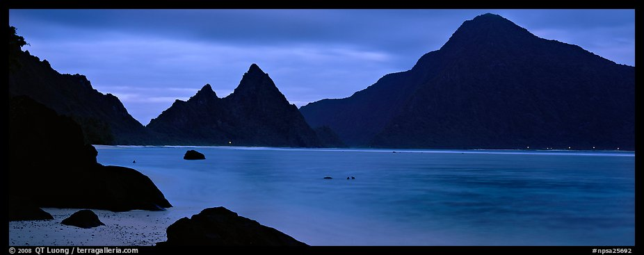 Bay with coastal peaks at dusk. National Park of American Samoa (color)