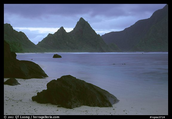 Balsalt boulders on South Beach, Sunuitao Peak in the background, Ofu Island. National Park of American Samoa (color)