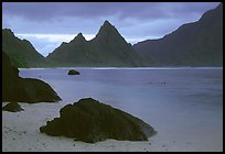 Balsalt boulders on South Beach, Sunuitao Peak in the background, Ofu Island. National Park of American Samoa