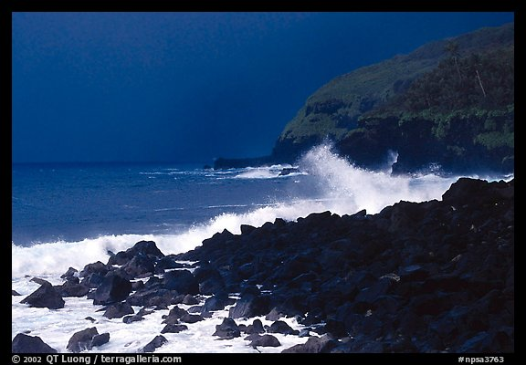 Dark boulders, crashing waves, and dark sky, storm light, Tau Island. National Park of American Samoa (color)
