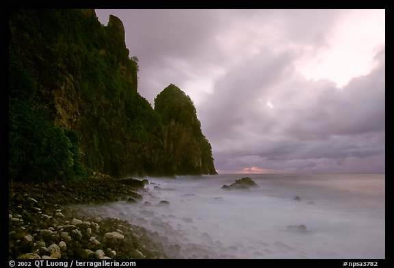 Peeble beach and Pola Island, stormy sunrise, Tutuila Island. National Park of American Samoa (color)
