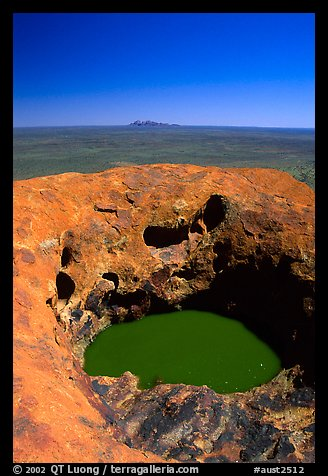 Green pool on Ayers Rock, Olgas in a distance. Uluru-Kata Tjuta National Park, Northern Territories, Australia (color)