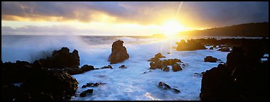 Primeval seascape with surf and rising sun. Maui, Hawaii, USA (Panoramic color)
