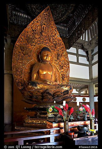 Amida seated on a lotus flower, the largest Buddha statue carved in over 900 years, Byodo-In Temple. Oahu island, Hawaii, USA (color)