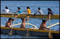 Outriggers canoes during late afternoon practice, Maunalua Bay. Oahu island, Hawaii, USA (color)