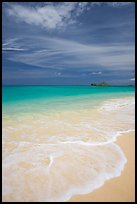 Foam, sand, and turquoise waters, Waimanalo Beach. Oahu island, Hawaii, USA