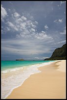 Sand, turquoise waters, and cliff, Waimanalo Beach. Oahu island, Hawaii, USA