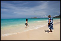 Two women, the older in hawaiian dress, on Waimanalo Beach. Oahu island, Hawaii, USA ( color)