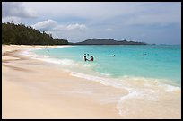 Couple and other bathers in the water, Waimanalo Beach. Oahu island, Hawaii, USA ( color)