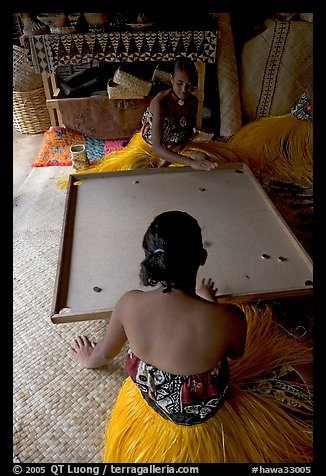 Fiji women playing a traditional game similar to pool. Polynesian Cultural Center, Oahu island, Hawaii, USA (color)