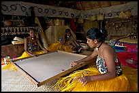 Fiji women playing at a traditional pool table in vale ni bose house. Polynesian Cultural Center, Oahu island, Hawaii, USA (color)