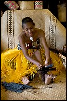 Fiji woman using her feet to tie leaves. Polynesian Cultural Center, Oahu island, Hawaii, USA ( color)