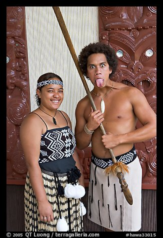 Maori woman and man sticking out his tongue. Polynesian Cultural Center, Oahu island, Hawaii, USA (color)