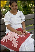 Woman making a traditional hawaiian quilt. Polynesian Cultural Center, Oahu island, Hawaii, USA
