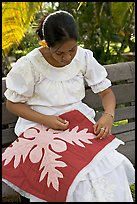 Woman quilting. Polynesian Cultural Center, Oahu island, Hawaii, USA