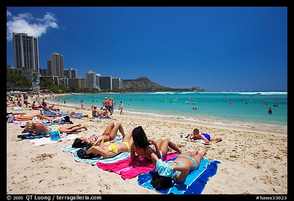 Young women sunning on Waikiki Beach. Waikiki, Honolulu, Oahu island, Hawaii, USA (color)