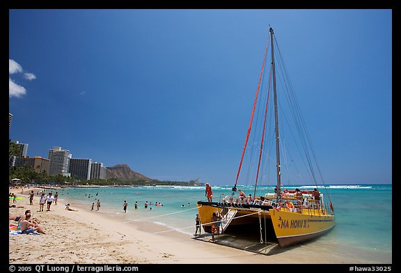Catamaran and Waikiki Beach. Waikiki, Honolulu, Oahu island, Hawaii, USA (color)