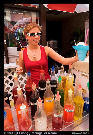 Woman handing out a cup of shave ice. Waikiki, Honolulu, Oahu island, Hawaii, USA (color)
