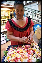 Woman preparing a fresh flower lei, International Marketplace. Waikiki, Honolulu, Oahu island, Hawaii, USA (color)