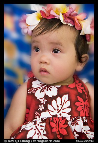 Baby girl in hawaiian dress wearing a flower lei on her head. Waikiki, Honolulu, Oahu island, Hawaii, USA (color)