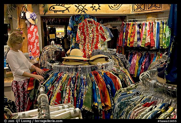 Woman shopping hawaiian dresses. Waikiki, Honolulu, Oahu island, Hawaii, USA (color)