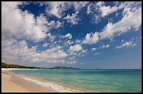 Waimanalo Beach and ocean with turquoise waters and clouds. Oahu island, Hawaii, USA
