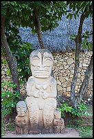 Marquesas statue and walls. Polynesian Cultural Center, Oahu island, Hawaii, USA (color)