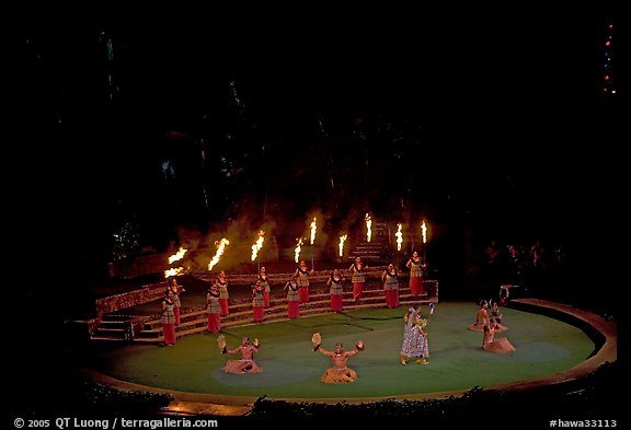 Wedding procession led by torch bearers performed by Tahitian dancers. Polynesian Cultural Center, Oahu island, Hawaii, USA (color)